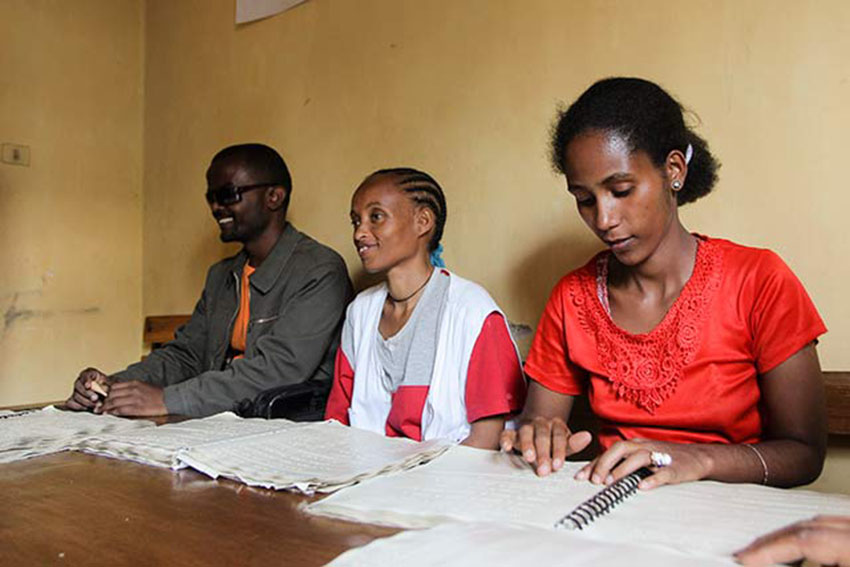 Students learning to read and write Braille