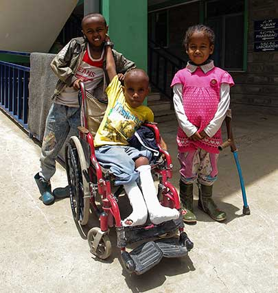 Yeabsira and his hospital buddies outside CURE Hospital.