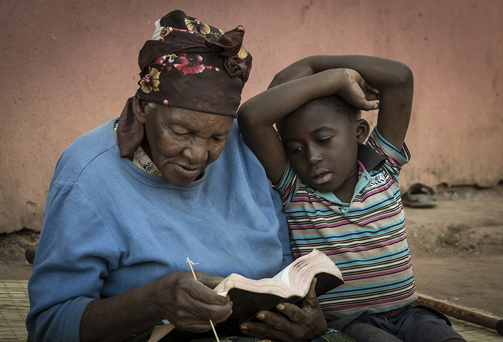 Bessie reading the bible to her grandson