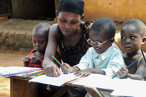 Gafaro with his mother doing school work