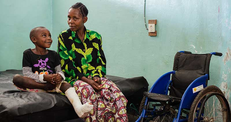 Pascal with his mother Riziki, sitting at the hospital after surgery