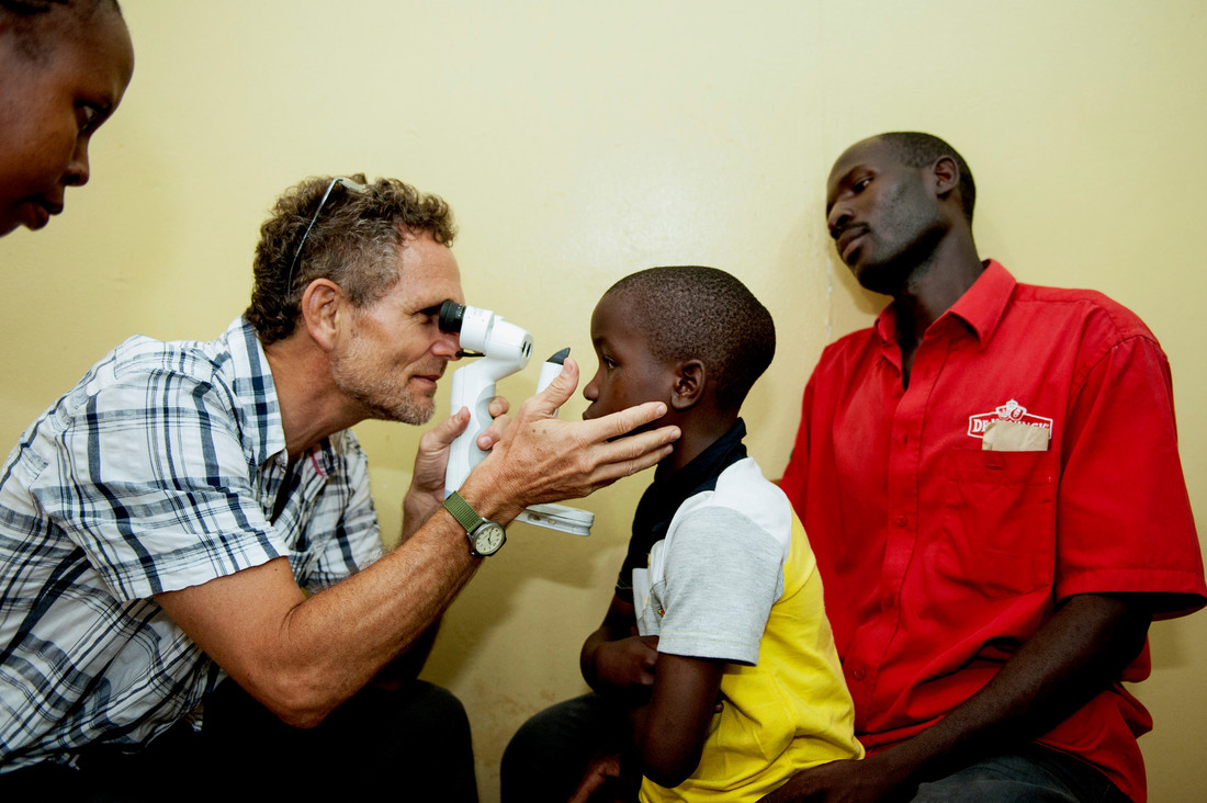 Doctor examines child in Tanzania