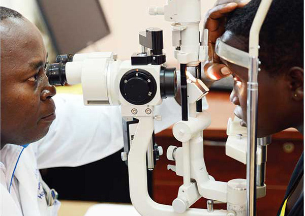 Ophthalmologist checking women's eye's for cataracts