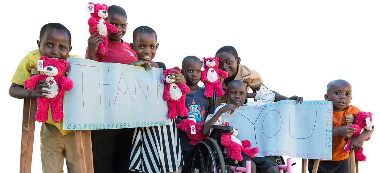 Kids with disability with Thank You sign