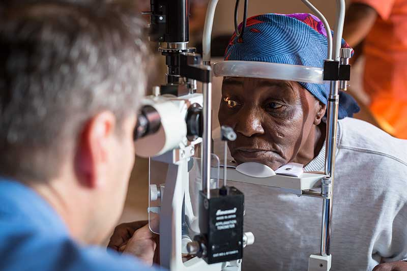 Dr. Pons examining Sonile right eye by looking through a slit lamp