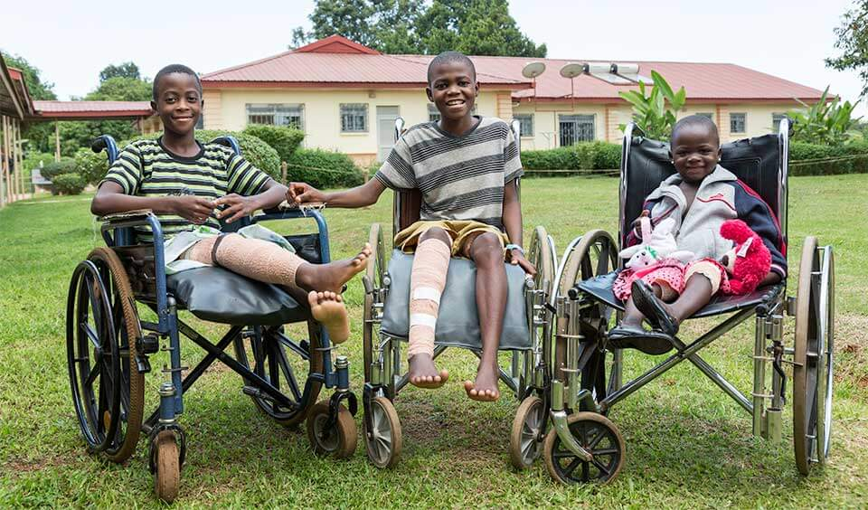 Kids in wheelchairs smiling