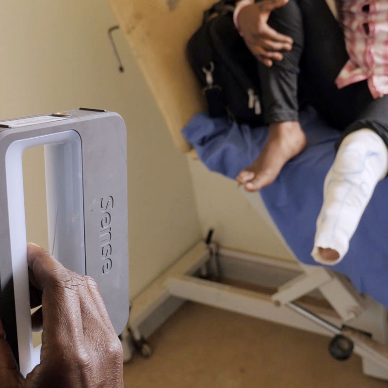 Technician scanning a patients leg with a hand held scanner