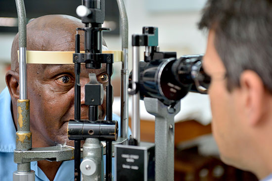 Omari getting eyes checked by doctor