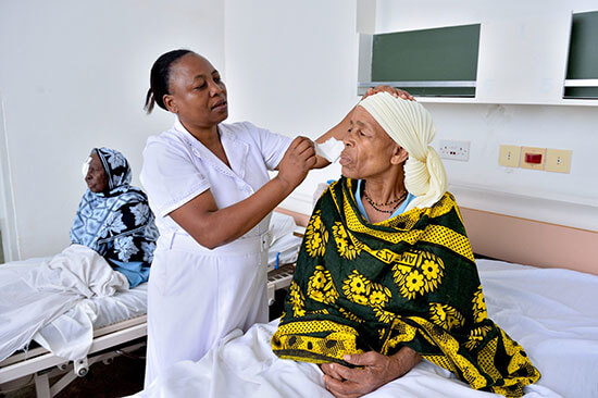 Theresia getting eye dressing removed