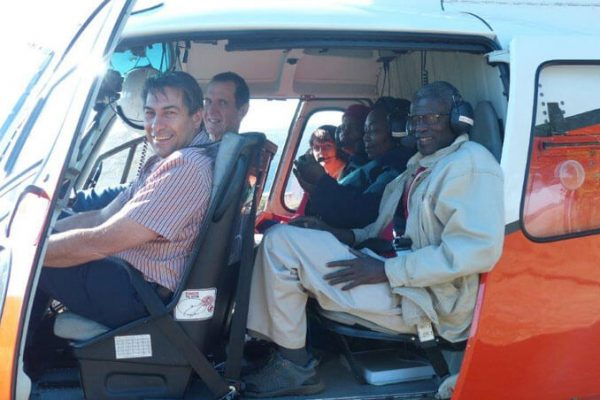 Dr. Pons and crew in helicopter