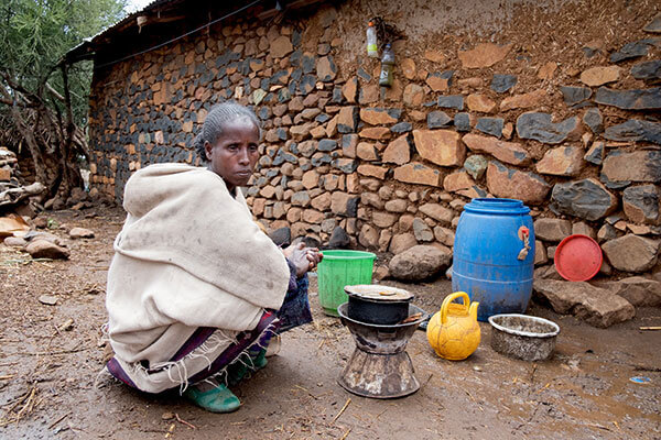 Dinknesh, 38, at her kitchen behind her home in Amhara Region, Ethiopia, on May 17, 2017