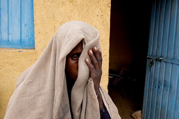 Dinknesh prepares to walk home after trichiasis surgery at the health post in Amhara Region, Ethiopia, on May 17, 2017